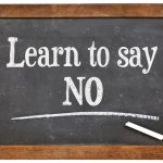 "Slate with ""Learn to Say No"" written on it"