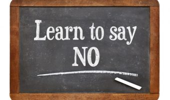 """Slate with """"Learn to Say No"""" written on it"""