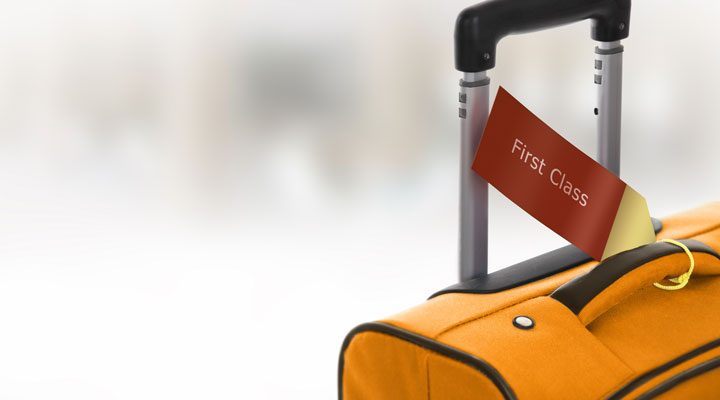 """photo: suitcase with """"First Class"""" tag on it"""